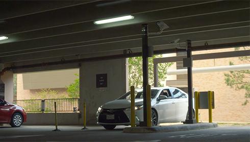 white sedan entering into gateless garage